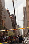 NEW YORK - MAY 31: AC Unit Falls From Crane in Midtown Manhattan
