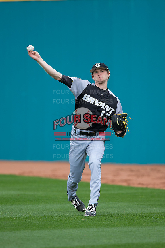 Bryant Bulldogs starting pitcher Kyle Wilcox (15) warms up in the outfield prior to the game against the Coastal Carolina Chanticleers at Springs Brooks Stadium on March 13, 2015 in Charlotte, North Carolina.  The Chanticleers defeated the Bulldogs 7-2.  (Brian Westerholt/Four Seam Images)