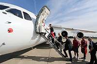 Wednesday 07 August 2013<br /> Pictured: Manager Michael Laudrup (3rd L) boarding the aeroplane at Cardiff Airport.<br /> Re: Swansea City FC travelling to Sweden for their Europa League 3rd Qualifying Round, Second Leg game against Malmo.