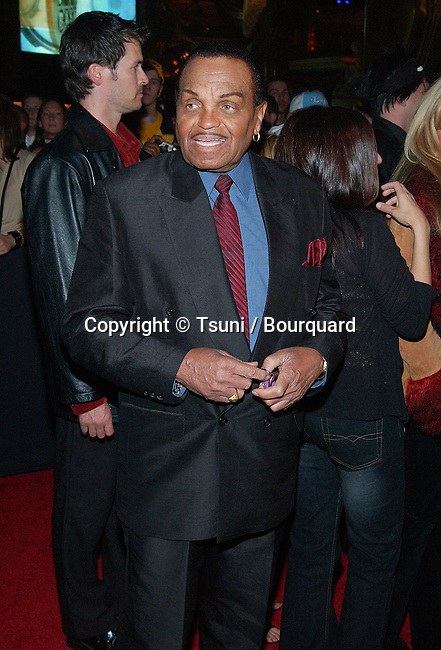 Michael Jackson's dad arriving at The Billboard Bash Party at the MGM Studio 54 in Las Vegas, NV. December 8, 2002.          -            Jackson_dad008.jpg