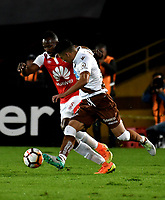 BOGOTA - COLOMBIA - 20 - 02 - 2018: Juan David Valencia (Izq.) jugador de Independiente Santa Fe disputa el balón con Juan Soto (Der.) jugador de Santiago Wanderers, durante partido de vuelta entre Independiente Santa Fe (COL) y Santiago Wanderers (CHL), de la fase 3 llave 1, por la Copa Conmebol Libertadores 2018, jugado en el estadio Nemesio Camcho El Campin de la ciudad de Bogota. / Juan David Valencia (L) player of Independiente Santa Fe vies for the ball with Juan Soto (R) player of Santiago Wanderers, during a match for the second leg between Independiente Santa Fe (COL) and Santiago Wanderers (CHL), of the 3rd phase key 1, for the Copa Conmebol Libertadores 2018 at the Nemesio Camacho El Campin Stadium in Bogota city. Photo: VizzorImage  / Luis Ramirez / Staff.