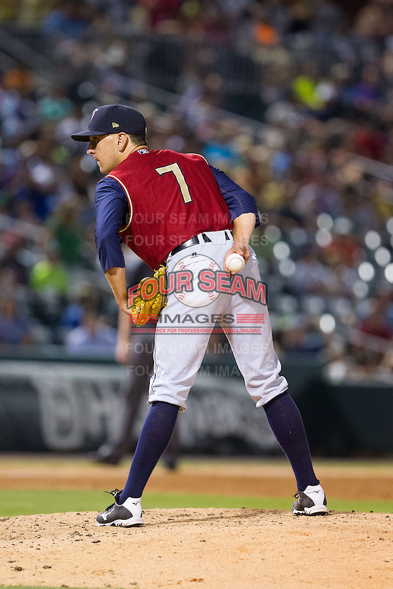 Scranton/Wilkes-Barre RailRiders relief pitcher Pat Venditte (7) looks to his catcher for the sign against the Charlotte Knights at BB&T Ballpark on July 17, 2014 in Charlotte, North Carolina.  The Knights defeated the RailRiders 9-5.  (Brian Westerholt/Four Seam Images)
