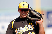 Ryan Hege (42) of the Wichita State Shockers smiles as he walks back to the dugout during a game against the Missouri State Bears on April 9, 2011 at Hammons Field in Springfield, Missouri.  Photo By David Welker/Four Seam Images