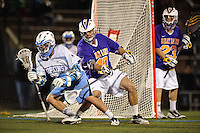 Baltimore, MD - April 5: Defensemen Cody Futia # 40 of the Albany Great Dane's defends Attackmen Wells Stanwick #42 of the John Hopkins Blue Jays during the Albany v Johns Hopkins mens lacrosse game at  Homewood Field on April 5, 2012 in Baltimore, MD. (Ryan Lasek/Eclipse Sportwire)