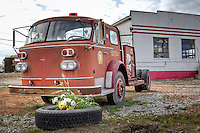 "An old fire  truck sits at the Historic Kan-O-Tex service station in Galena Kansas on route 66.  The station has been restored and is now ""4 Women on the Route"" a sandwich and gift shop featuring route 66 and ""Car's"" items. The station is now named ""Cars on the Route"""