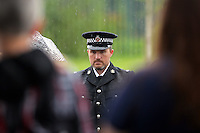 Pictured: A representative of South Wales Police attends the burial at Thornhill Cemetery, Cardiff, Wales, UK. Tuesday 28 June 2016<br /> Re: The funeral of Sion, the baby boy found dead in the River Taff in Cardiff has taken place<br /> Generous locals raised nearly &pound;1,400 for the memorial after reading about plans to hold a fitting ceremony for the newborn baby whose body was discovered in Cardiff a year ago.<br /> The funeral took place at the Briwnant Chapel at Thornhill Crematorium, Cardiff. Members of the public are invited to be among the congregation.