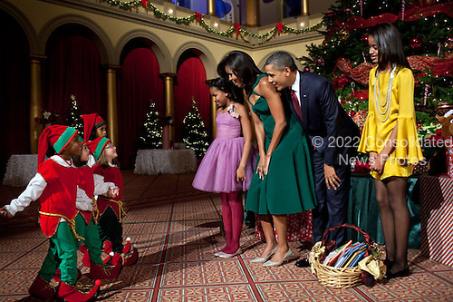 United States President Barack Obama, First Lady Michelle Obama and daughters Sasha and Malia attend the Christmas in Washington taping at the National Building Museum in Washington, D.C., December 11, 2001. .Mandatory Credit: Pete Souza - White House via CNP