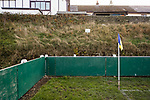 A sign warning people to keep off the steep grass banking. The Look Local Stadium is built on the side of a valley. Stocksbridge Park Steels v Pickering Town, Evo-Stik East Division, 17th November 2018. Stocksbridge Park Steels were born from the works team of the local British Steel plant that dominates the town north of Sheffield.<br />