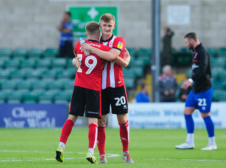 Lincoln City's Joe Morrell, left, and Lincoln City's Callum Connolly at the end of the game<br /> <br /> Photographer Chris Vaughan/CameraSport<br /> <br /> The EFL Sky Bet League One - Lincoln City v Fleetwood Town - Saturday 31st August 2019 - Sincil Bank - Lincoln<br /> <br /> World Copyright © 2019 CameraSport. All rights reserved. 43 Linden Ave. Countesthorpe. Leicester. England. LE8 5PG - Tel: +44 (0) 116 277 4147 - admin@camerasport.com - www.camerasport.com