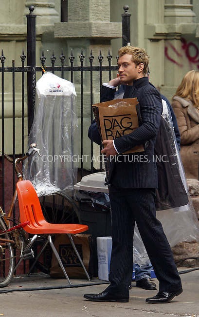 Jude Law on the set of 'Alfie' in New York. November 22, 2003. Please byline: NY Photo Press.   ..*PAY-PER-USE*      ....NY Photo Press:  ..phone (646) 267-6913;   ..e-mail: info@nyphotopress.com