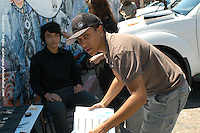 AJ Alexander - Director Erika Liciaga in forground and Make Up Artist Jessica Fierro working on Jashua Staich (Gregory) on the set of Mind Over Matter on Friday May 13, 2011..Photo by AJ Alexander