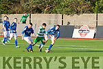 Wayne Sparling, Killarney Celtic, bursts through two Castleisland players, Mikey Mauncell and Ray Huggard (Lt) to advance on goal when the sides met at Mounthawk Park, Tralee last Saturday evening.