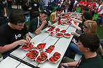 Stover Harger seems to be holding his own amongst his competitors of this year's crawfish eating contest.
