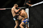 Las Vegas, NV - May 24, 2014: UFC featherweights, <br /> Sam Sicilia (black trunks) lands a knee on Aaron Phillips (blue trunks) during their fight at UFC 173 at The MGM Grand Garden Arena inside the MGM Resort and Casino in Las Vegas, NV. (Al Powers for ESPN)
