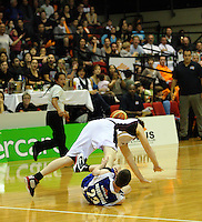 Heat forward Dillon Boucher and Saints' Eric Devendorf collide during the National Basketball League match between the Wellington Saints and Harbour Heat at TSB Bank Arena, Wellington, New Zealand on Thursday, 29 April 2010. Photo: Dave Lintott / lintottphoto.co.nz