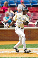 Kevin Jordan #21 of the Wake Forest Demon Deacons follows through on his swing against the Florida State Seminoles at Wake Forest Baseball Park on March 25, 2012 in Winston-Salem, North Carolina.  The Demon Deacons defeated the Seminoles 7-5.  (Brian Westerholt/Four Seam Images)