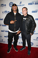 LOS ANGELES, CA - NOVEMBER 7: L.L. Cool J, Shepard Fairey, at Photo Op For Hulu's 'Obey Giant at the The Theatre at Ace Hotel in Los Angeles, California on November 7, 2017. <br /> CAP/MPI/FS<br /> &copy;FS/MPI/Capital Pictures