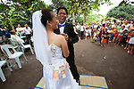 A bride and groom celebrate on their wedding at an outdoor reception in a rural area near San Jose, Negros Oriental, Philippines.
