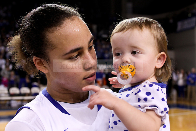 Kentucky guard Makayla Epps holds head coach Matthew Mitchell's daughter after the second half of the UK vs. South Carolina at Memorial Coliseum in Lexington , Ky., on Sunday, March 1, 2015. Photo by Jonathan Krueger | Staff