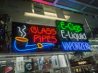 A convenience store in Williamsburg, Brooklyn in New York on Sunday, May 1, 2016 promotes its vaping and other merchandise. (© Richard B. Levine)