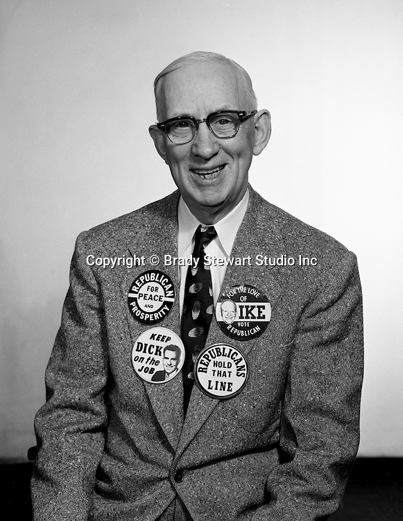 Client: A.G. Trimble Company<br /> Ad Agency: none<br /> Contact: Mr. Arthur Trimble<br /> Product: Promotional Buttons<br /> Location: Brady Stewart Studio, 725 Liberty Avenue Pittsburgh<br /> <br /> Mr. A. G. Trimble modeling his Political buttons - 1960.  The AG Trimble company was an Advertising Specialties company located in the Jenkins Arcade building in Downtown Pittsburgh and known throughout the country.