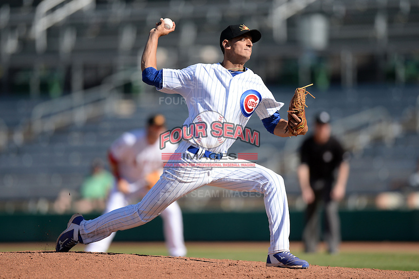 Mesa Solar Sox pitcher Armando Rivero (36), of the Chicago Cubs organization, during an Arizona Fall League game against the Scottsdale Scorpions on October 15, 2013 at HoHoKam Park in Mesa, Arizona.  Mesa defeated Scottsdale 7-4.  (Mike Janes/Four Seam Images)