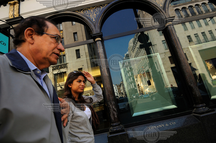 Shoppers on London's Bond Street passing Tiffany & Co jewellers.
