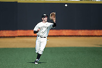 Wake Forest Demon Deacons left fielder Kevin Conway (7) catches a fly ball during the game against the Richmond Spiders at David F. Couch Ballpark on March 6, 2016 in Winston-Salem, North Carolina.  The Demon Deacons defeated the Spiders 17-4.  (Brian Westerholt/Four Seam Images)