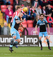 Stevenage's Scott Cuthbert is fouled by Lincoln City's Mark O'Hara<br /> <br /> Photographer Chris Vaughan/CameraSport<br /> <br /> The EFL Sky Bet League Two - Lincoln City v Stevenage - Saturday 16th February 2019 - Sincil Bank - Lincoln<br /> <br /> World Copyright © 2019 CameraSport. All rights reserved. 43 Linden Ave. Countesthorpe. Leicester. England. LE8 5PG - Tel: +44 (0) 116 277 4147 - admin@camerasport.com - www.camerasport.com