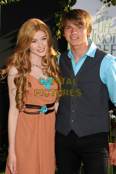 "Katherine McNamara, Joel Courtney.""The Odd Life of Timothy Green"" Los Angeles Premiere, Hollywood, California, USA..August 6th, 2012.half length dress shirt waistcoat grey gray necklace orange turquoise .CAP/ADM/BP.©Byron Purvis/AdMedia/Capital Pictures."