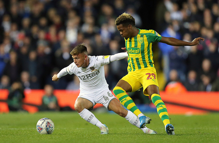 Leeds United's Jamie Shackleton holds off the challenge from West Bromwich Albion's Grady Diangana<br /> <br /> Photographer Rich Linley/CameraSport<br /> <br /> The EFL Sky Bet Championship - Tuesday 1st October 2019  - Leeds United v West Bromwich Albion - Elland Road - Leeds<br /> <br /> World Copyright © 2019 CameraSport. All rights reserved. 43 Linden Ave. Countesthorpe. Leicester. England. LE8 5PG - Tel: +44 (0) 116 277 4147 - admin@camerasport.com - www.camerasport.com