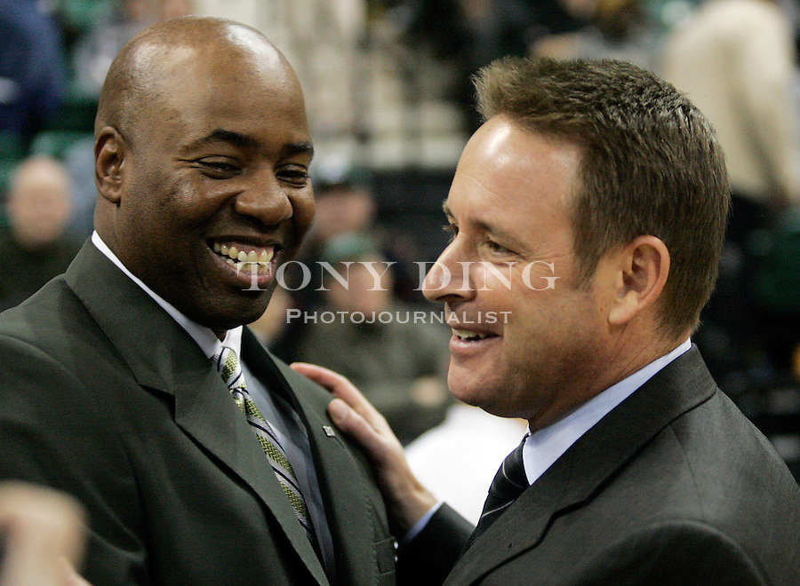 Eastern Michigan's first year head coach Charles Ramsey, left, greets former EMU coaching legend and current Cal head coach Ben Braun at a ceremony before California's match vs Eastern Michigan on Friday, Nov. 18, 2005 in Ypsilanti, Mich. (AP Photo/Tony Ding)