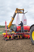 Filling forage maize drill with fertiliser - May; Norfolk
