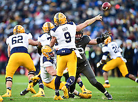 Baltimore, MD - DEC 10, 2016: Navy Midshipmen quarterback Zach Abey (9) gets the ball right before he's hit during game between Army and Navy at M&T Bank Stadium, Baltimore, MD. (Photo by Phil Peters/Media Images International)