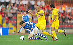 St Johnstone v Eskisehirspor....18.07.12  Uefa Cup Qualifyer.Murray Davidsin is fouled by Diomansy Kamara.Picture by Graeme Hart..Copyright Perthshire Picture Agency.Tel: 01738 623350  Mobile: 07990 594431