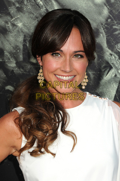"Nikki DeLoach.""The Possession"" Los Angeles Premiere held at Arclight Cinemas, Hollywood, California, USA..August 28th, 2012.headshot portrait dangling earrings gold white sleeveless  .CAP/ADM/BP.©Byron Purvis/AdMedia/Capital Pictures."