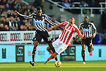 Stoke's Steven N'Zonzi gets tangled in the legs of Sammy Ameobi of Newcastle United - Newcastle United vs. Stoke City - Barclay's Premier League - St James' Park - Newcastle - 08/02/2015 Pic Philip Oldham/Sportimage