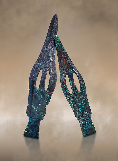 Hittite bronze spear heads. Hittite Period 1650 - 1450 BC, Ortakoy Sapinuva . Çorum Archaeological Museum, Corum, Turkey. Against a warm art bacground.