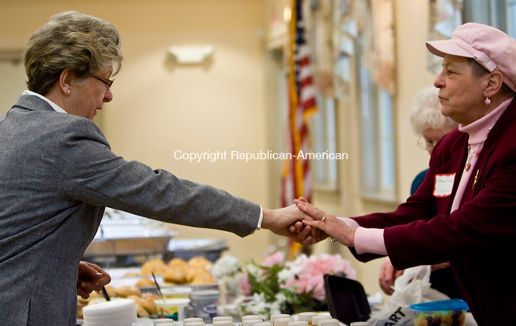 OXFORD, CT - 10 APRIL 2008 -112008JT24-<br /> Oxford First Selectman Mary Ann Drayton-Rogers, who lost a spouse to cancer, holds the hands of Marie Tyrrell, working as Oxford Senior Center's activities director, during a function at the new senior center building in Oxford on April 10, 2008. <br /> Josalee Thrift / Republican-American