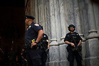 NEW YORK, NY - APRIL 16: NYPD officers stand guard after the arrival of Cardinal Timothy Dolan  to St. Patrick's Cathedral for mass during the Annual Easter parade on April 16, 2017 in New York City.  The Easter Parade and Easter Bonnet Festival is characterized by revelers dressed in their holiday finery, which typically includes handmade hats, while they gather around St. Patrick's Cathedral to show their creations. Photo by VIEWpress/Eduardo MunozAlvarez