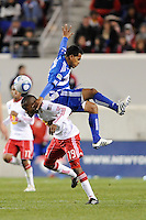 David Ferreira (10) of FC Dallas and Dane Richards (19) of the New York Red Bulls collide going for a header. The New York Red Bulls defeated FC Dallas 2-1 during a Major League Soccer (MLS) match at Red Bull Arena in Harrison, NJ, on April 17, 2010.