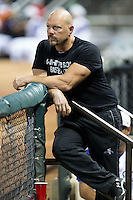 Winston-Salem Dash strength coach Shawn Powell takes in the action from the dugout during the game against the Wilmington Blue Rocks at BB&T Ballpark on July 30, 2015 in Winston-Salem, North Carolina.  The Dash defeated the Blue Rocks 7-3.  (Brian Westerholt/Four Seam Images)