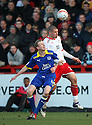 Michael Bostwick of Stevenage wins a header from Marc Laird of Leyton Orient.- Stevenage v Leyton Orient - npower League 1 - Lamex Stadium, Stevenage - 2nd January 2012  .© Kevin Coleman 2012