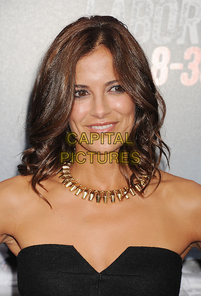 Rebecca Budig<br /> &quot;Getaway&quot; Los Angeles Premiere held at the Regency Village Theatre, Westwood, California, USA.<br /> August 26th, 2013<br /> headshot portrait black strapless gold necklace   <br /> CAP/ROT/TM<br /> &copy;Tony Michaels/Roth Stock/Capital Pictures