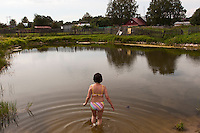 Korovikha, Ivanova Region, Russia, 05/08/2012..Weekend swimmers in the village pond in Korovikha, some 200 miles east of Moscow.