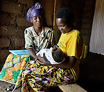 Community Health Worker Marie Chantal examines r three-week old newborn, and talks to the mother,  in Batamuliza Hururiro village, near Rukumo Health Center, Rwanda