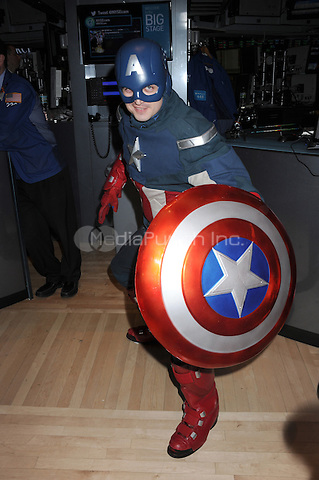NEW YORK, NY - APRIL 1: Captain America on hand as castmembers ring the opening bell at the New York Stock Exchange promoting Marvel's Captain America: The Winter Soldier film on April 1, 2014 in New York City. Credit: mpi01/MediaPunch