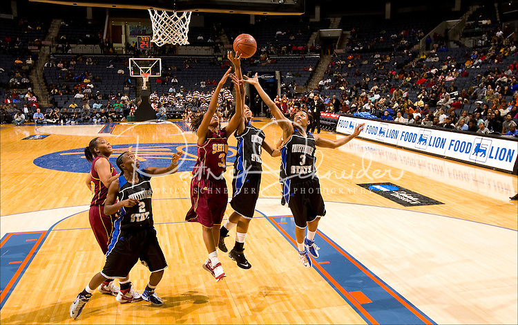 Female basketball players battle for a rebound during the CIAA Tournament  in Charlotte, NC.