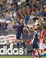 New England Revolution forward Milton Caraglio (9) heads the ball. In a Major League Soccer (MLS) match, Chivas USA defeated the New England Revolution, 3-2, at Gillette Stadium on August 6, 2011.