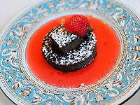 Chocolate dessert with strawberry sauce